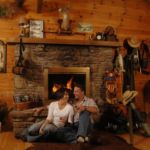Couples cabin, couple by fire